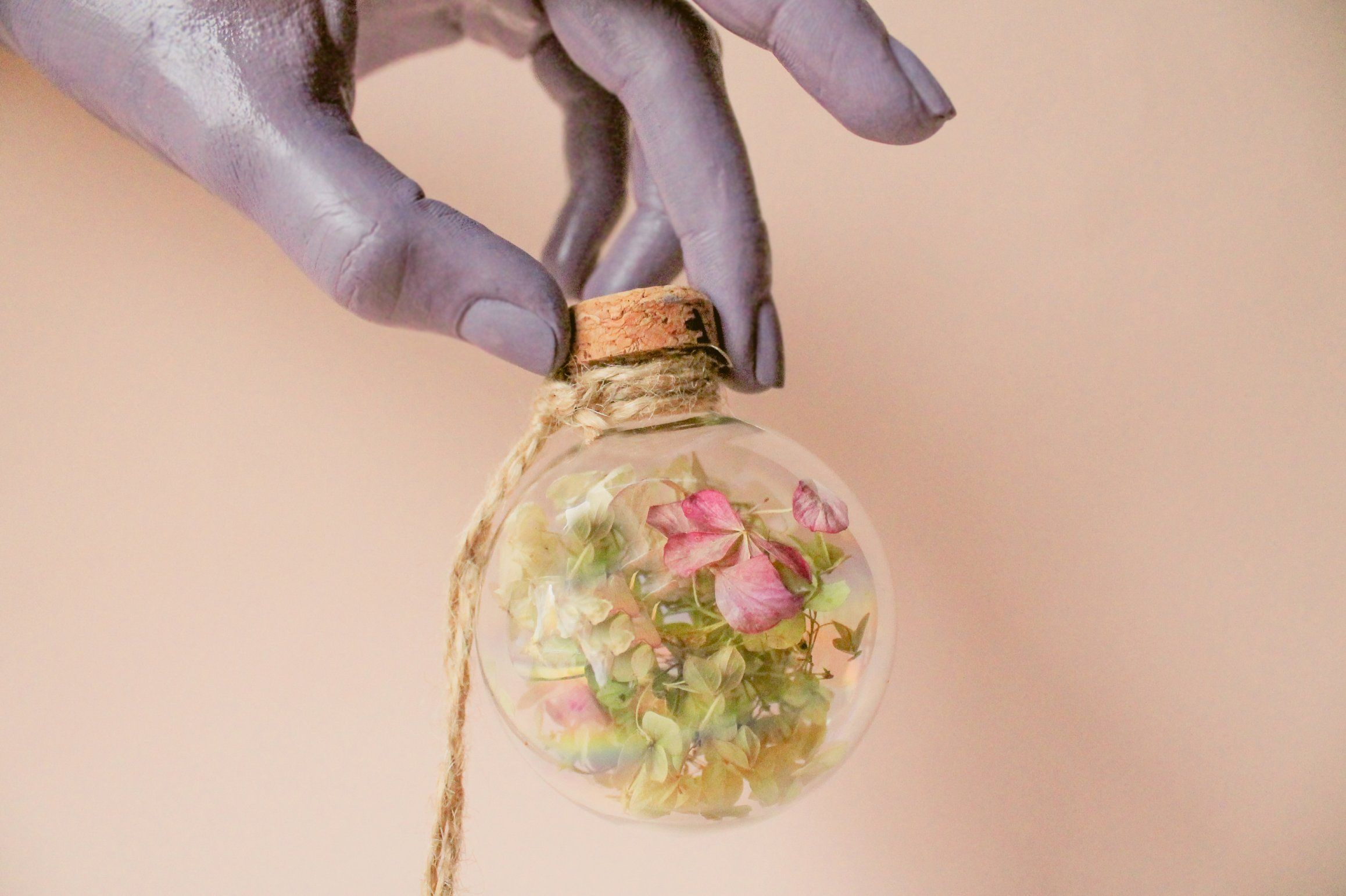 Holiday tree decoration with hydrangea Glass ornament with a real flower and a meaningful message